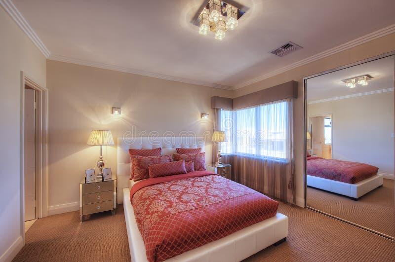 Luxury Home Bedroom. Luxury Home Interior Queensize Bedroom royalty free stock photography