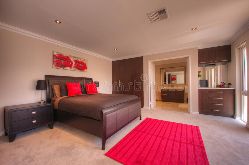 Luxury Home Bedroom. With featuring red and brown theme royalty free stock photos