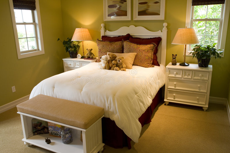Luxury home bedroom. Luxury home kids bedroom with toys royalty free stock images