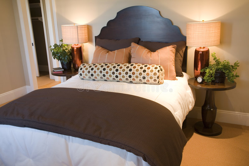 Luxury home bedroom. Comfortable bedroom and modern decor in a luxury home stock images