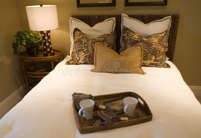 Luxury home bedroom. With stylish furniture and a bed tray royalty free stock images