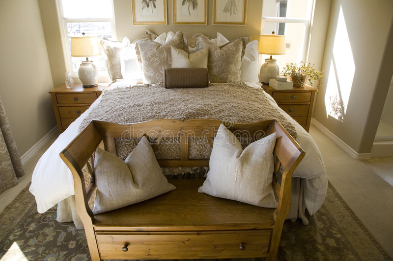 Luxury home bedroom. Comfortable bedroom in a luxury home stock photography