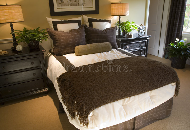 Luxury home bedroom. Luxury home bedroom with stylish furniture and decor royalty free stock image