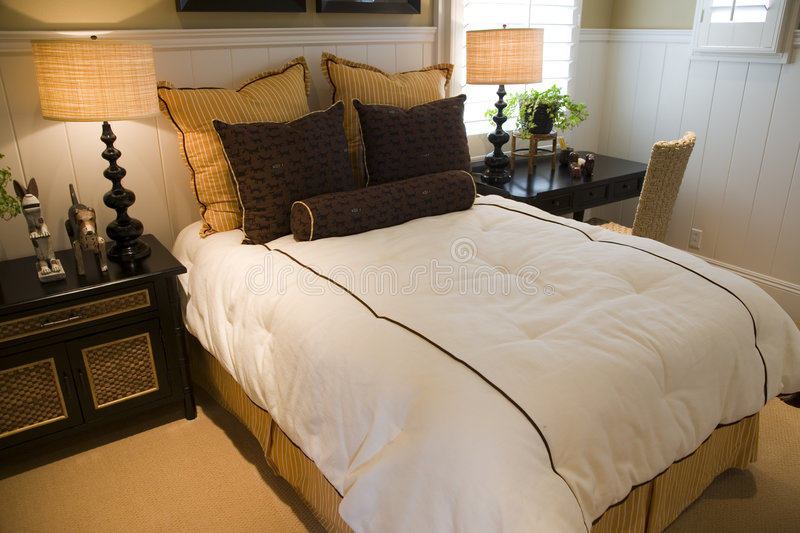Luxury home bedroom. Luxury home bedroom with stylish furniture and decor stock photo