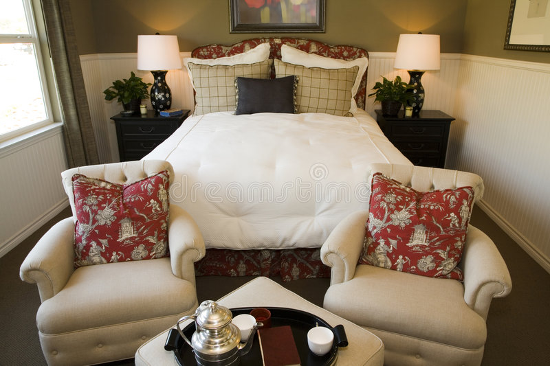 Luxury home bedroom. With stylish furniture and decor royalty free stock images