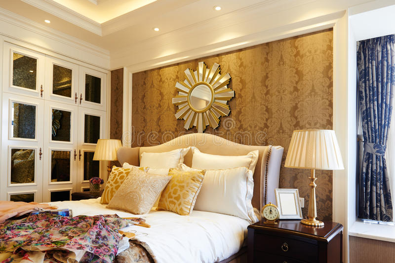 Luxury home bedroom. Comfortable bedroom in a luxury home with stylish decor royalty free stock photo