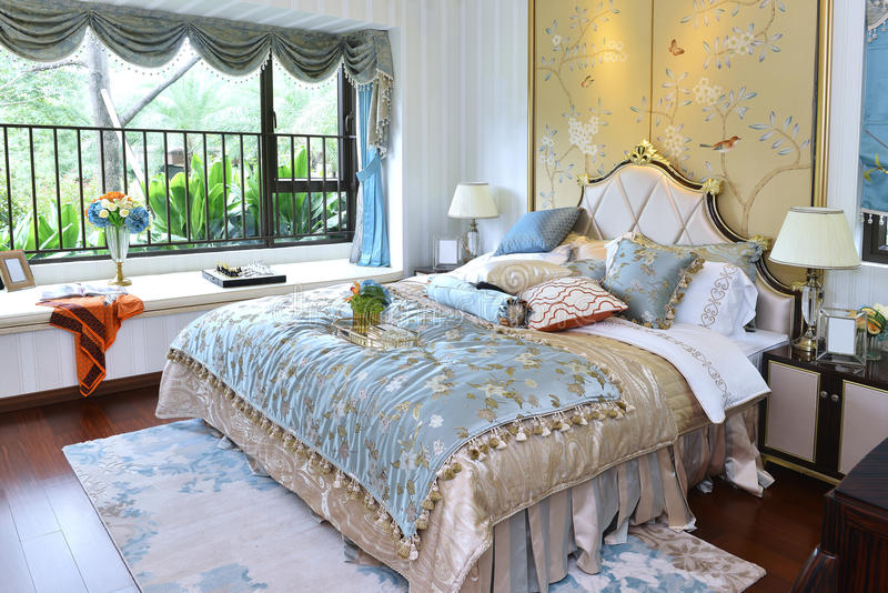 Luxury home bedroom. Comfortable bedroom in a luxury home with stylish decoration royalty free stock images