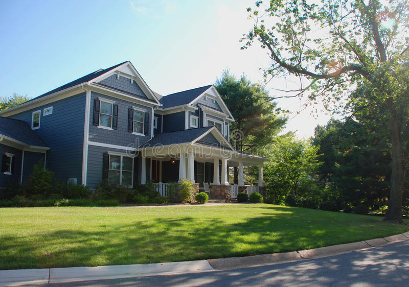 Luxury Home With Blue Siding and White Columns royalty free stock image