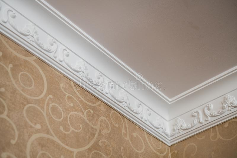 Luxury Home ceiling corner ornamental moulding detail stock photography