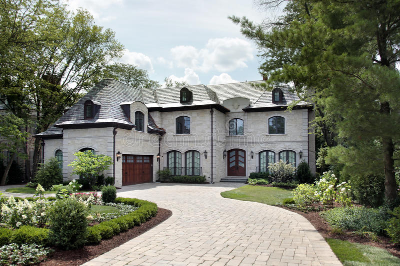 Luxury home with circular driveway royalty free stock photos