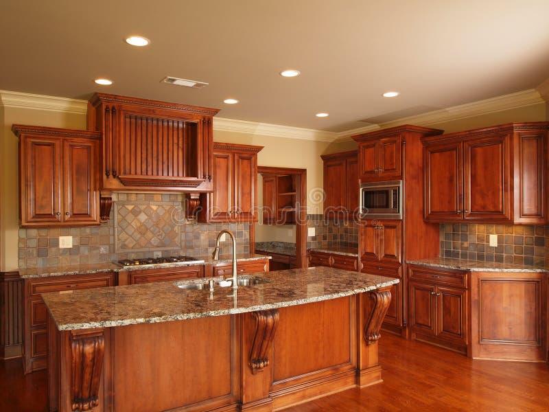 Luxury Home dark wood kitchen stock photos