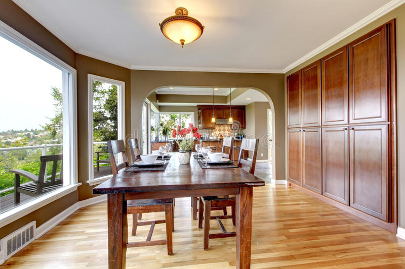 Luxury home dining room with wood and green. royalty free stock photo
