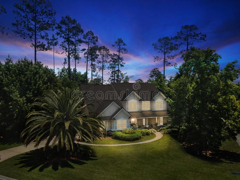 Luxury Home Exterior Dusk Dawn Night Lawn Sunset Interior Lights Turned on Horizontal Orientation Landscape Architectural. Luxury Home Exterior Dusk Dawn Night stock photos
