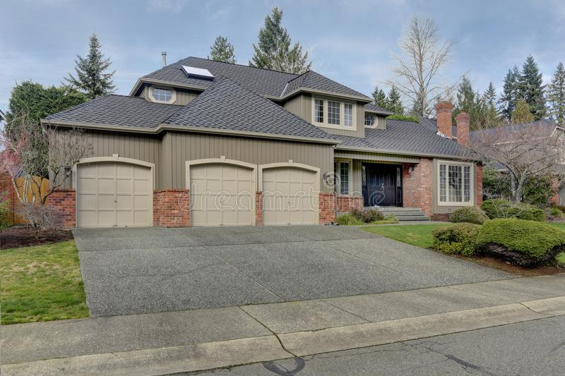 Luxury home exterior with three car garage. royalty free stock image