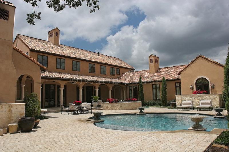 Luxury home looking over the pool royalty free stock image