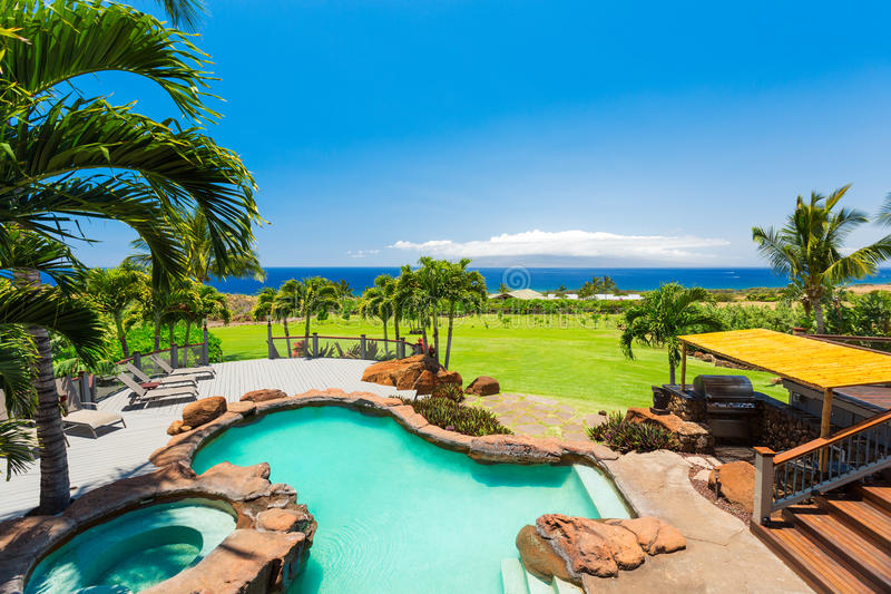Luxury home with swimming pool royalty free stock photography