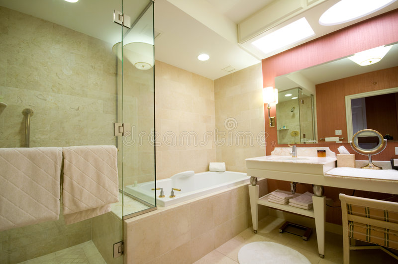 Luxury hotel bathroom. Modern, spacious luxury hotel bathroom royalty free stock photo