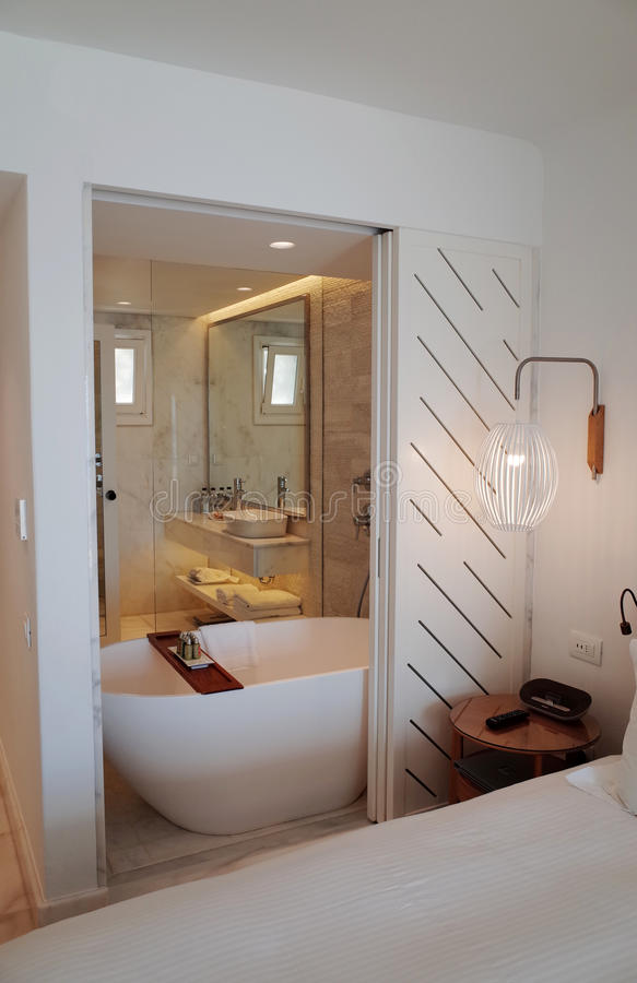 Luxury Hotel Bathroom. With sliding partition opening from the bedroom area royalty free stock images