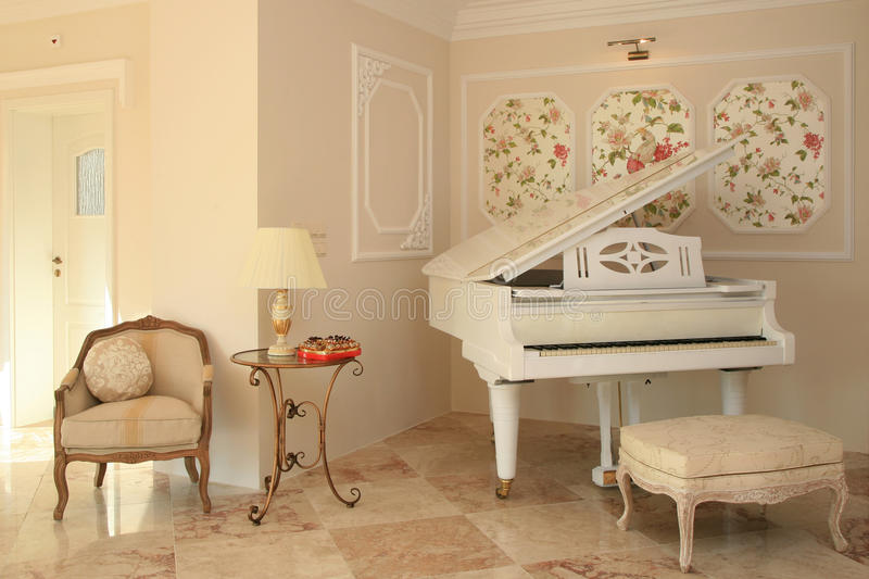 Luxury hotel interior. With white piano royalty free stock images