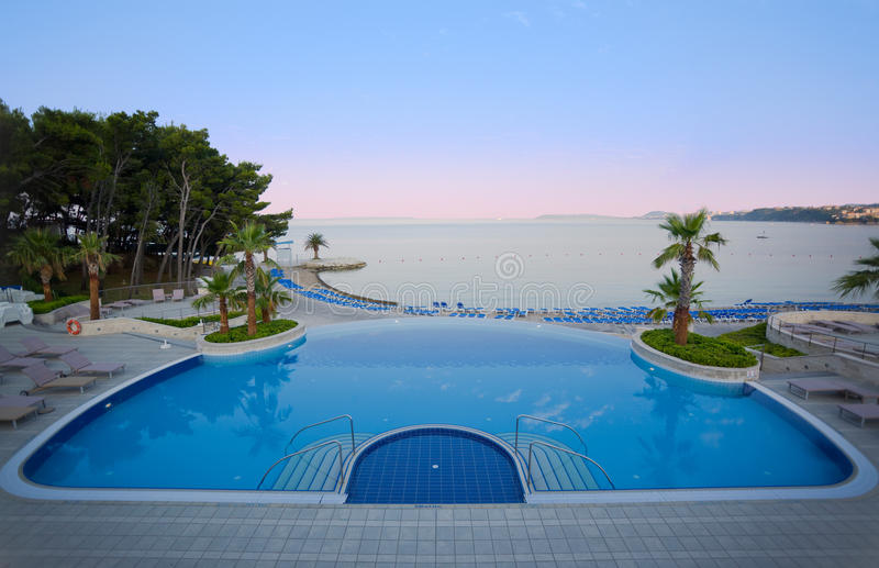 Luxury hotel pool with stunning sea view royalty free stock photography