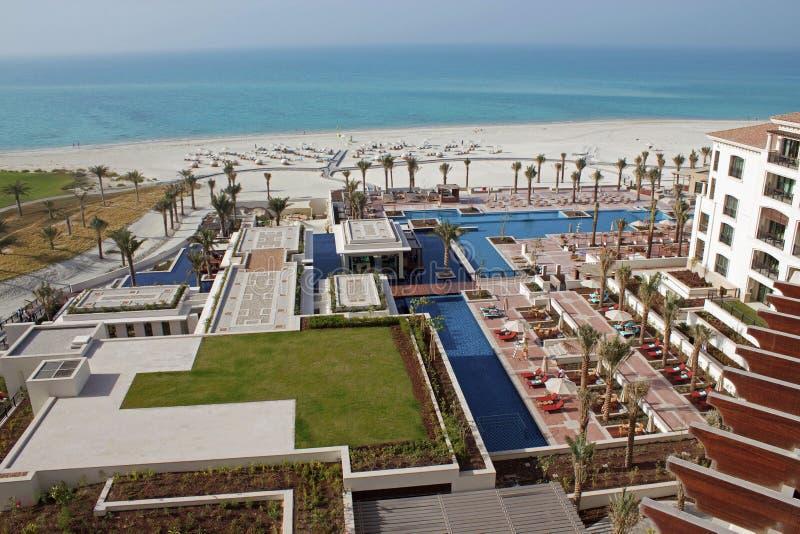 Luxury hotel pool and white sandy beach stock image