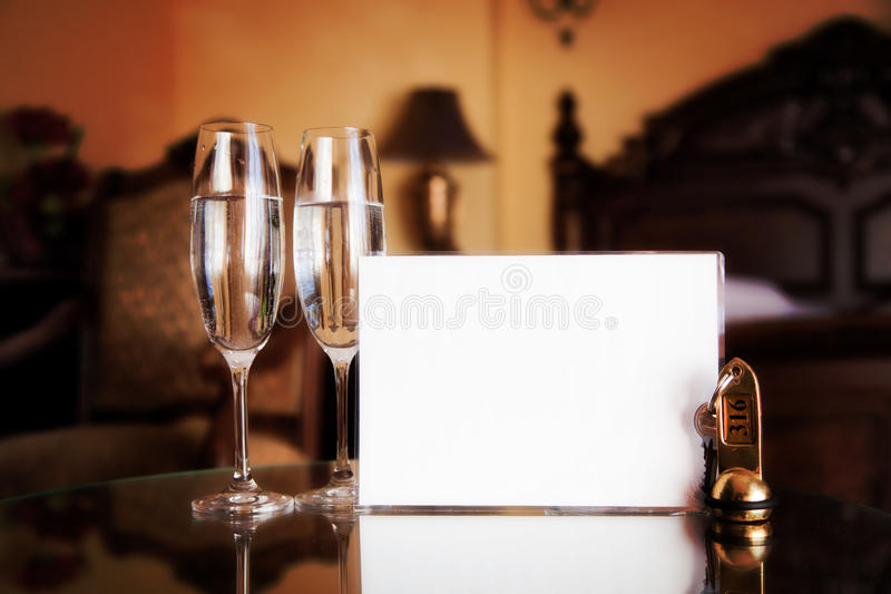 Luxury hotel room. Blank card. Luxury interior - hotel room with elegant service. Blank white card for your text royalty free stock photo