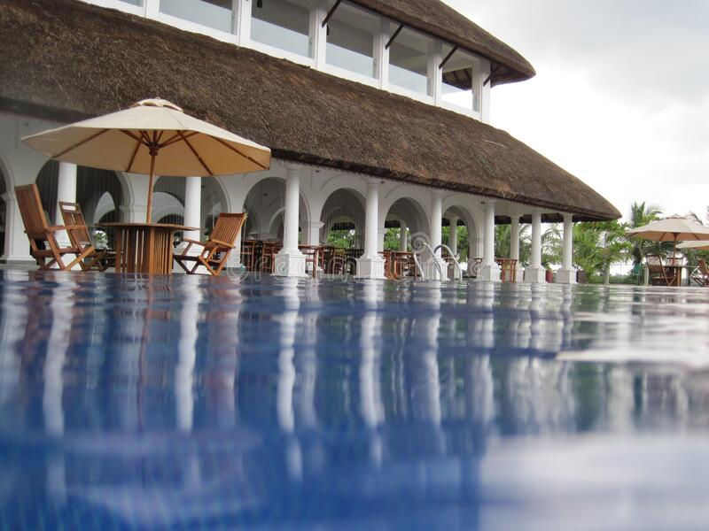 Luxury hotel with swimming pool royalty free stock photos