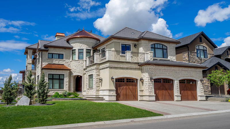 Luxury house in Calgary, Canada. Panorama of Luxury house on a sunny day in Calgary, Canada stock image