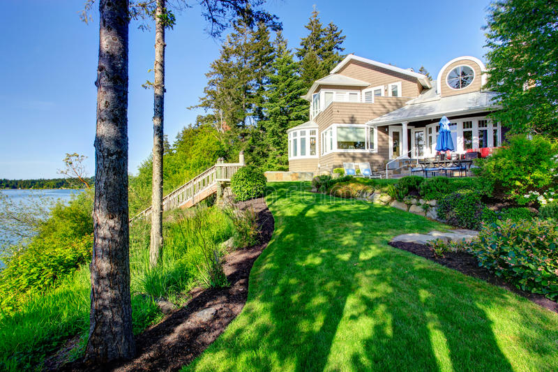Luxury house exterior with impressive backyard landscape design. stock photography