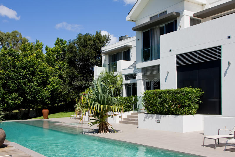 Luxury house with infinity pool stock photos
