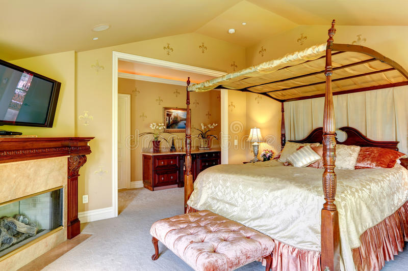Luxury House Interior. Beautiful Bed With High Posts Stock ...