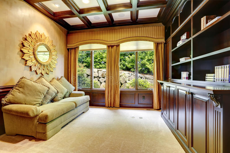 Luxury house interior. Office room. Luxury office with coffered ceiling and curtained window stock image