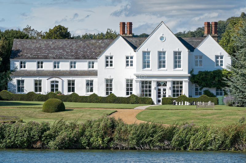 Luxury house on the River Thames. Luxury house with garden on the River Thames. Buckinghamshire, England stock photos