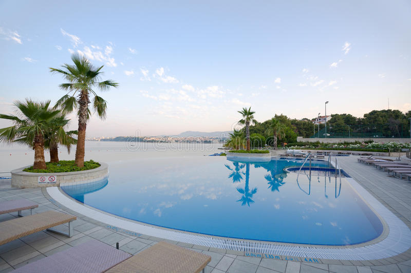 Luxury infinity pool with stunning sea view royalty free stock image