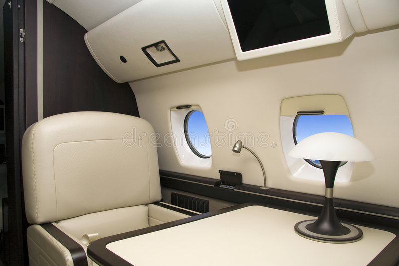 Luxury interior airplane. First Class (airplane for vip flight royalty free stock photo