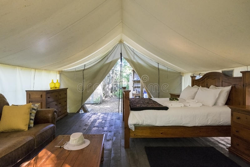 Luxury Interior of a Camp Tent in the Woods. Glamping Tent in the Woods stock images