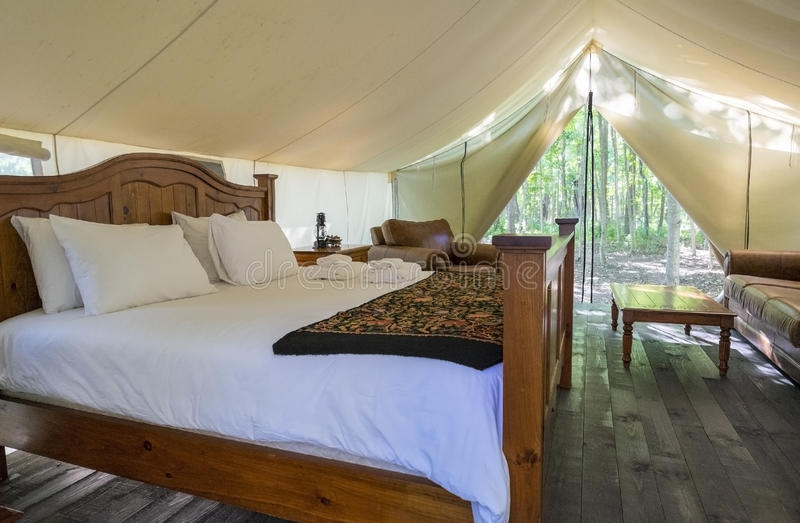 Luxury Interior of a Camp Tent in the Woods. Glamping Tent in the Woods stock photo