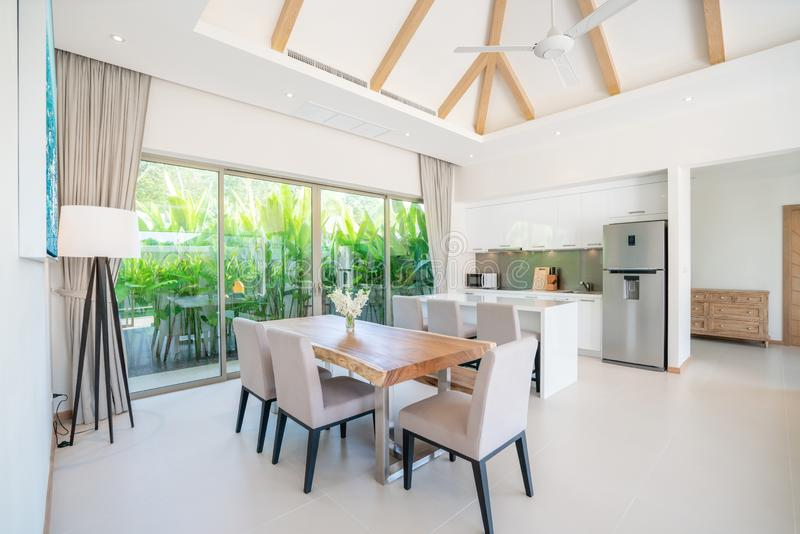 Luxury interior design kitchen area with dining table. And bright space stock photography