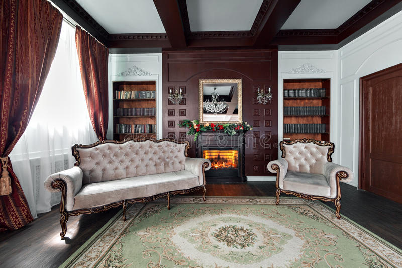 Luxury interior of home library. Sitting room with elegant furniture stock image