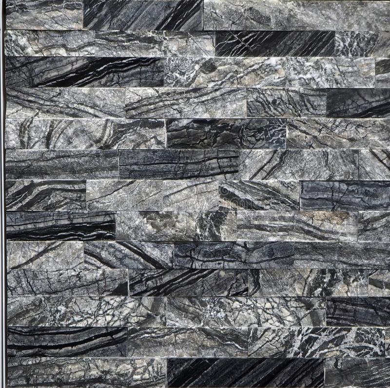 Luxury interior wall covering made of black and gray natural stone . royalty free stock photography