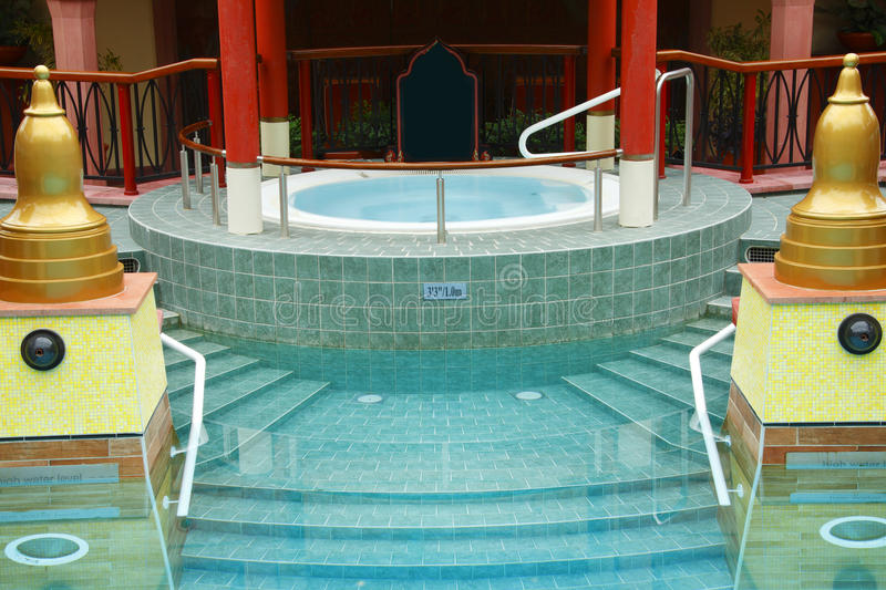 Luxury jacuzzi spa pool. With steps from swimming pool stock photos