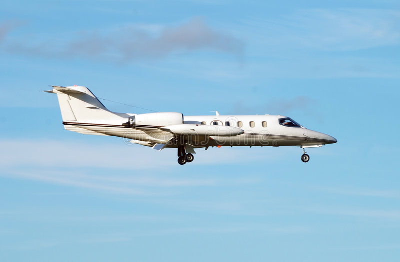 Luxury jet. Private jet transporting clients to business meeting royalty free stock image
