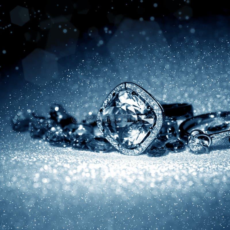 Luxury jewelry and brilliants. Elegant jewelry ring with jewel gems- brilliants in night light stock photos