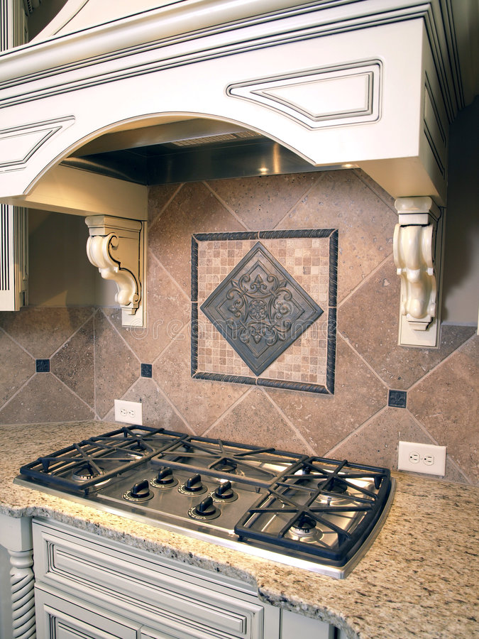 Luxury Kitchen Cooktop with Hood 2. Luxury Kitchen Cooktop Burners with Ornate Hood stock photos
