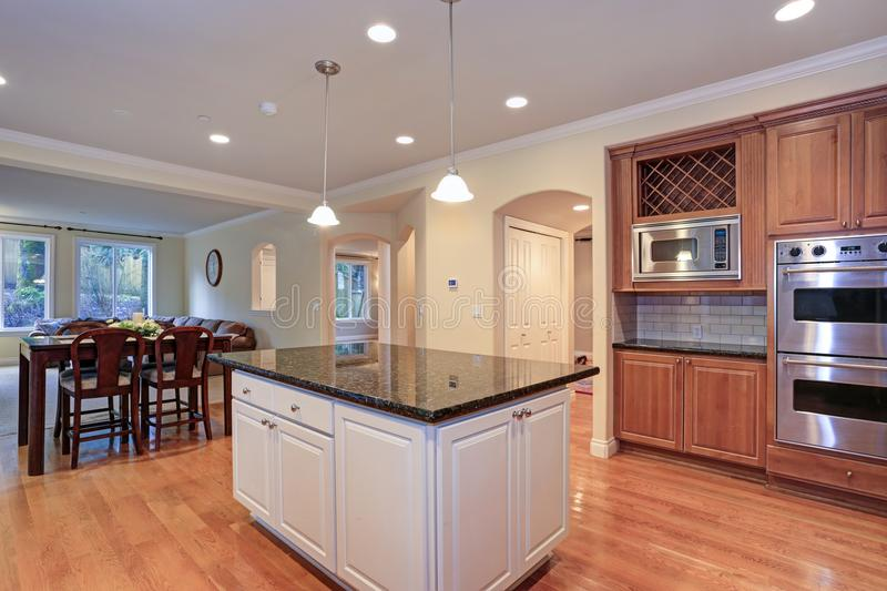 Luxury kitchen fitted with Viking appliances. Luxury kitchen with an island, light wood cabinets and Viking appliances stock photos