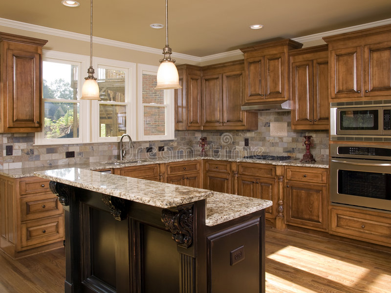 Luxury kitchen two tier island stock photo image of hard glass 6769266 - Cost to install kitchen island ...