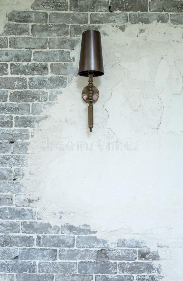 Luxury lamp hanging on brick and plaster wall stock photo