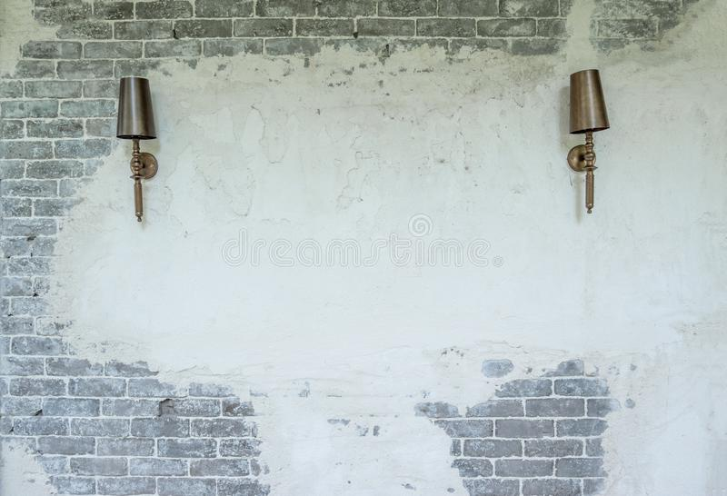 Luxury lamp hanging on brick and plaster wall stock images