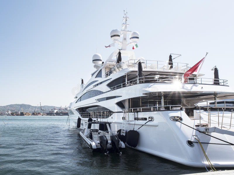 Luxury and large yacht. Luxury yacht anchored at the pier in the harbor royalty free stock photos