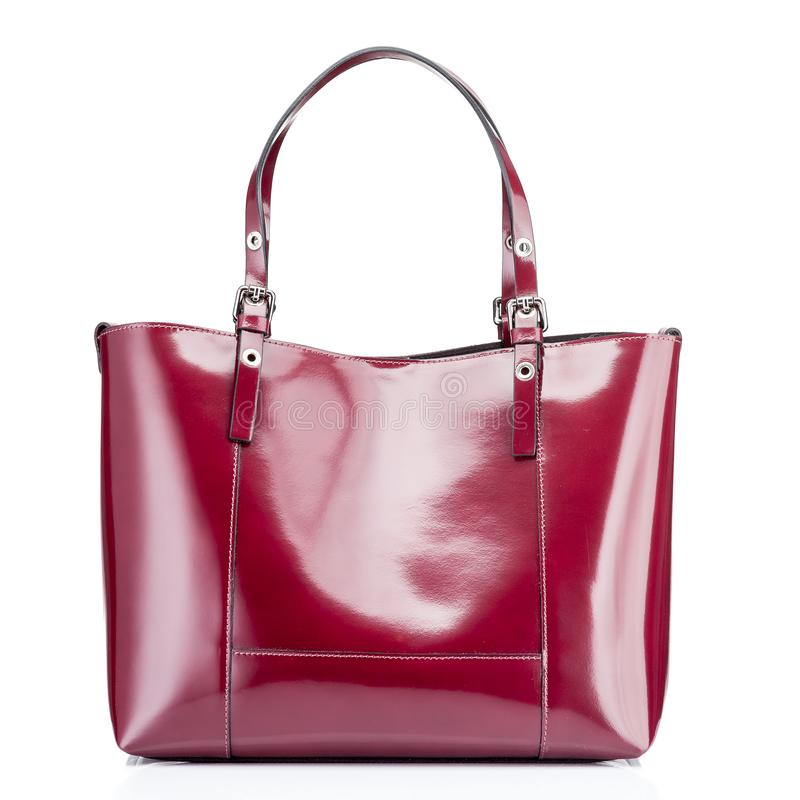Luxury leather red bag with zipper in bag for women. On white and top view, isolated included clipping path stock photo